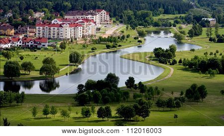 Horizontal image of beautiful Switzerland-like living quarters in Minsk Belarus with small river winding green grass and trees. ** Note: Soft Focus at 100%, best at smaller sizes stock photo