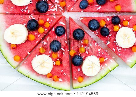 Vegan Snack from Watermelon Fruits and Berries - blueberry shredded coconut bananas Seabuckthorn berries stock photo