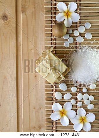 Soap,,wooden balls, tones and tiare flowers on the wooden background stock photo