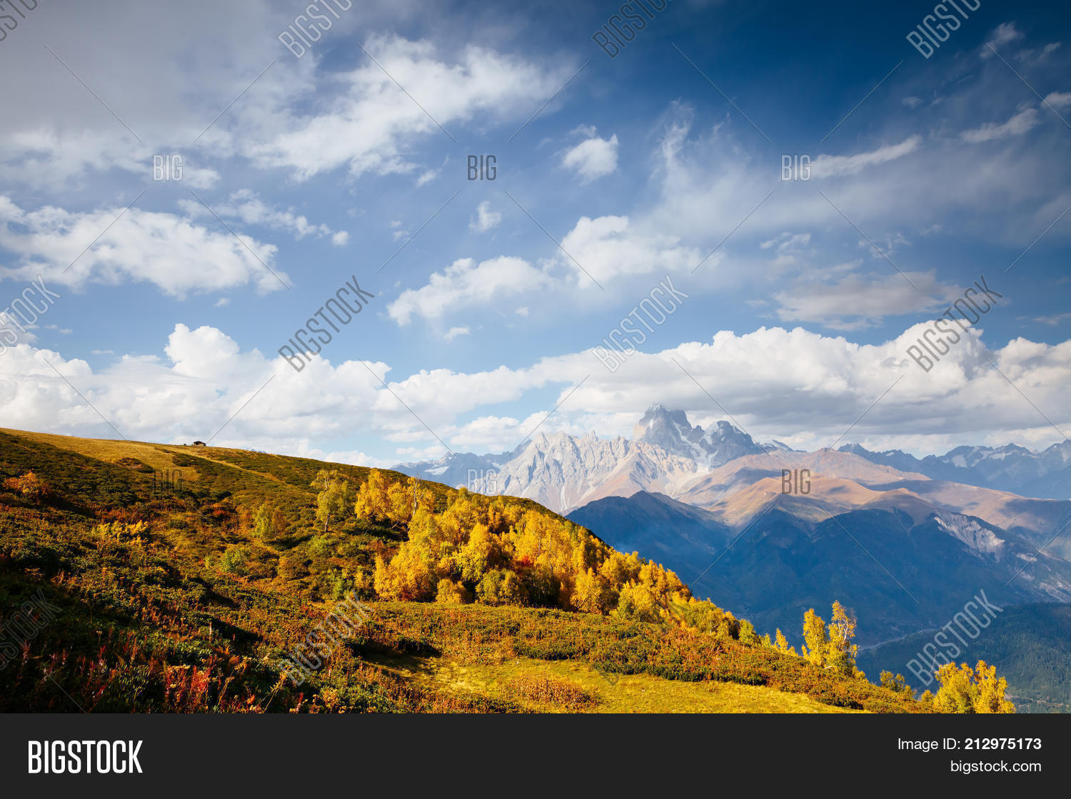 Alpine meadows in the sunny beams. Location Zemo Svaneti, Georgia country, Europe. Main Caucasian ridge. Scenic image of wild area. Explore the beauty of earth. Adventure and lifestyle hiking concept