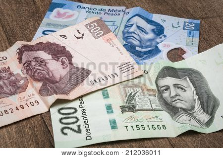 Bills of 20 200 and 500 mexican pesos seems to be sad perhaps because of its weakness against the dollar. stock photo