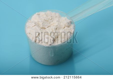Creatine monohydrate in scoop on creatine monohydrate background with empty place for your text. stock photo