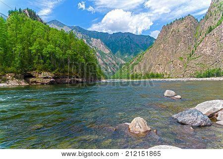 The Oka Sayanskaya River in the Orkho-Bom gorge. Sunny summer day. Buryatia Siberia Russia. stock photo