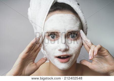 Amazed happy Woman use white cleanser mack,scrub on face stock photo