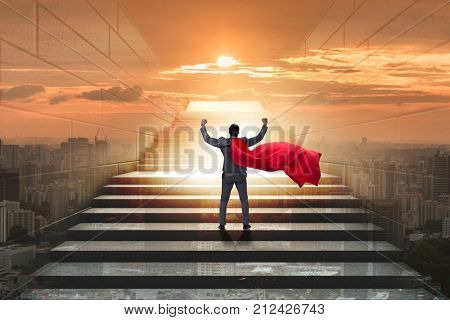Businessman superhero successful in career ladder concept stock photo