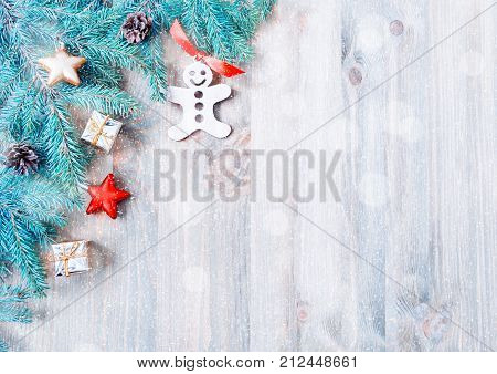 Christmas background. Christmas toys, blue fir tree branches on the wooden background. Christmas still life, free space for text. Background with Christmas concept. Christmas postcard. Festive Christmas background