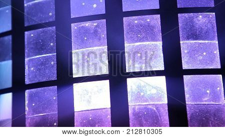 Stage lights. light-music. Several projectors in the dark. Purple spotlight strike through the darkness. glitter vintage lights background. dark gold and black. defocused. Disco HD stock photo