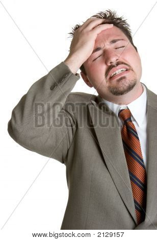 Handsome young white suited businessman stressed out stock photo