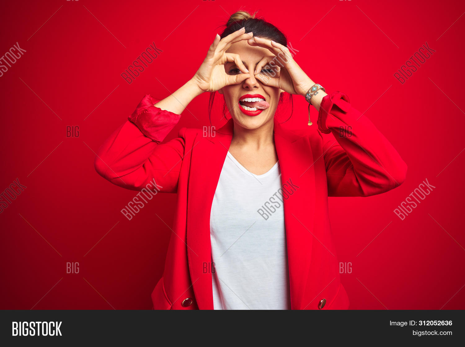 adult,approve,attractive,background,beautiful,binoculars,boss,brunette,business,cheerful,confident,crazy,doing,expression,eyes,face,female,finger,fingers,fun,funny,gesture,girl,hand,happiness,happy,hispanic,humor,isolated,jacket,look,looking,manager,mouth,ok,out,person,portrait,positive,red,sign,standing,sticking,studio,through,tongue,vision,woman,worker,young