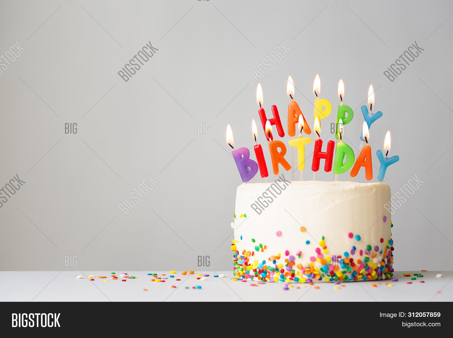 background,baked,birthday cake,birthday candles,birthday party,bright,brightly colored,cake,cakes,candle,candles,celebrate,celebration,colorful,copy space,copyspace,food,frosted,fun,gray,greeting,happy,happy birthday,home baked,home baking,home made,home-made,homemade,horizontal,letters,message,nobody,party,plain background,sprinkles,sweet,template,text,white,word,words,written