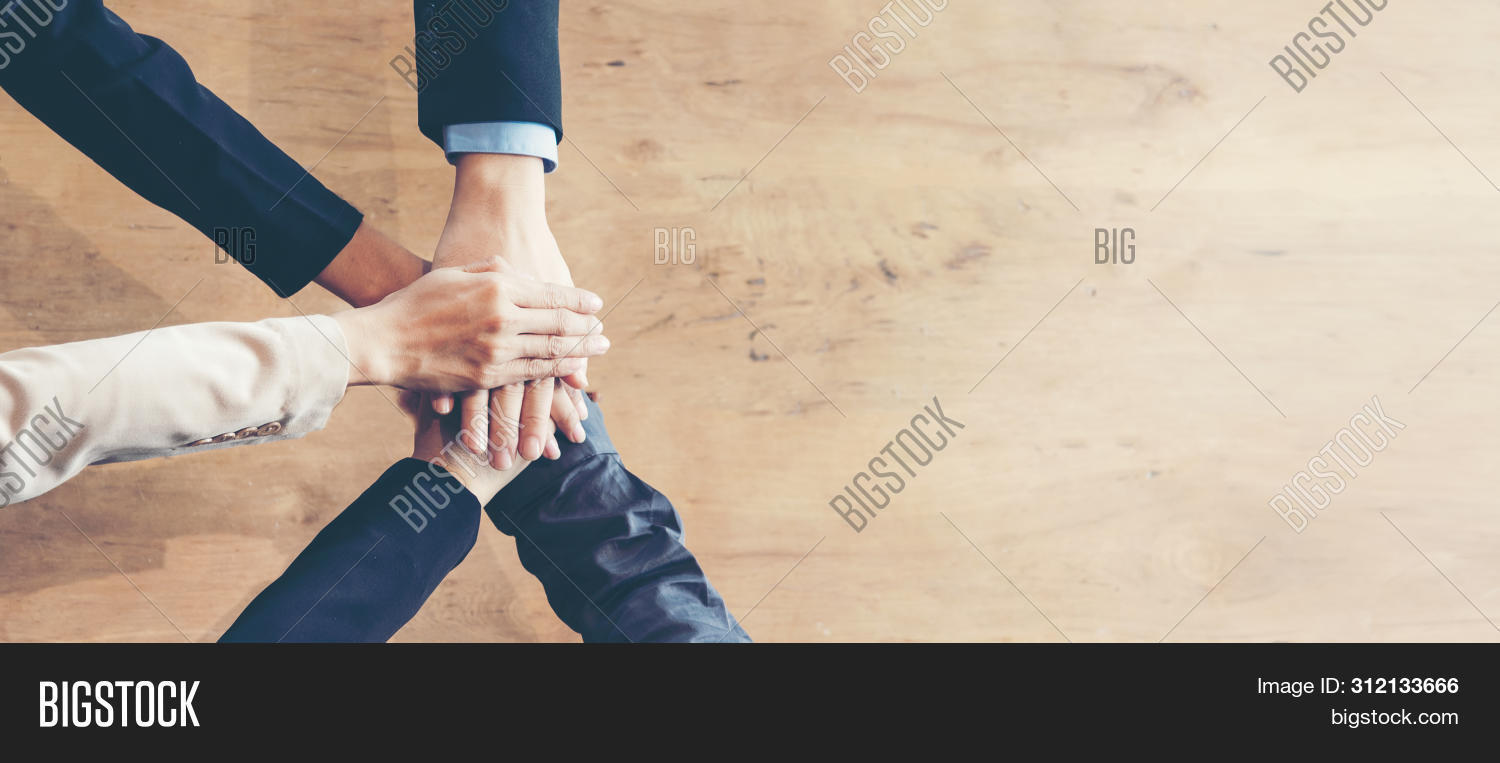 Partners Team Work Joining Hands To Success Together. Business Team Stack Of Hands For Star Up Proje
