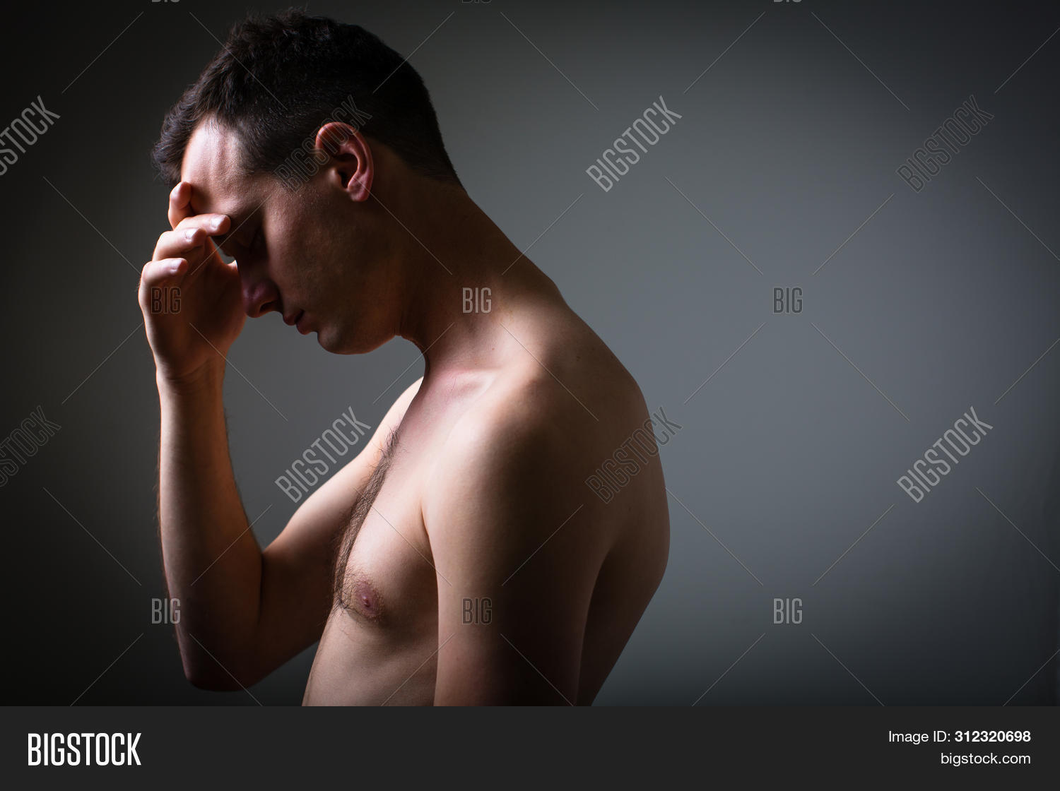 Depressed young man going through a rough patch in his life - suffering from mental exhaustion/anxie