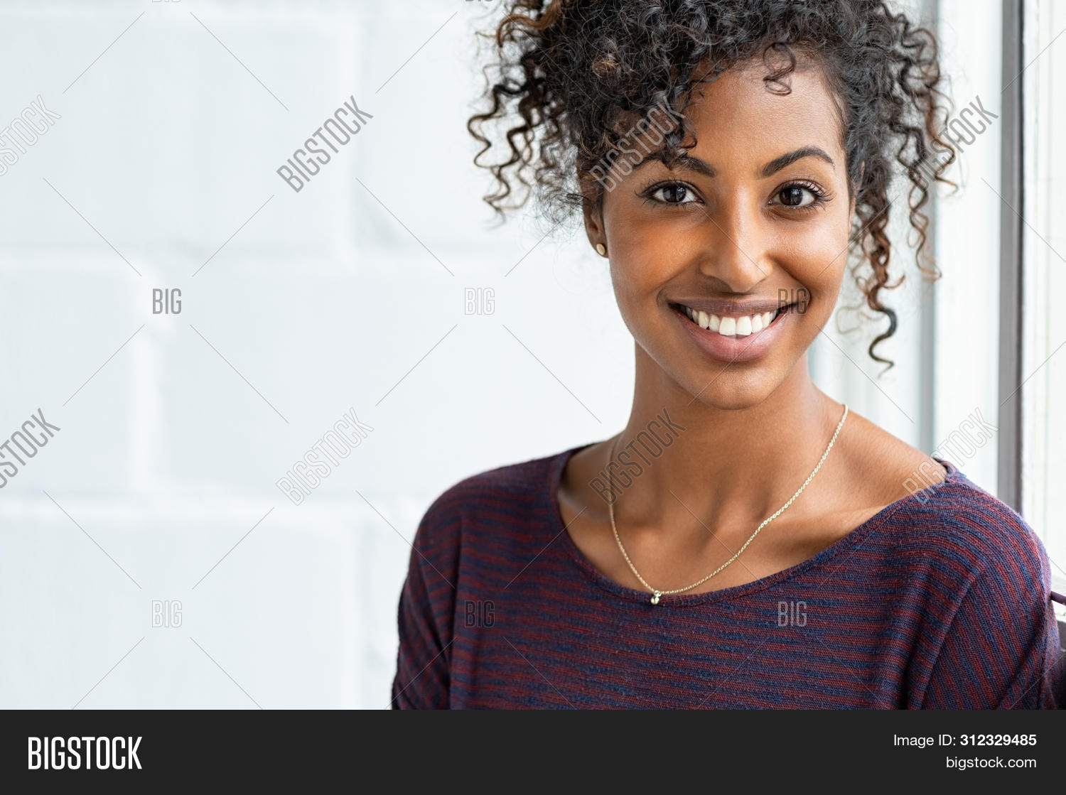 african,african american,afro,afro hair,american,attractive,beautiful,beautiful woman,beauty,black,business,business woman,carefree,casual,casual woman,cheerful,closeup,complexion,confident,copy space,curly,education,expression,face,fun,girl,happy,healthy,home,isolated,joy,looking,looking at camera,natural,natural beauty,near window,people,portrait,positive,pretty,real,real people,relax,smile,style,success,successful,toothy smile,young,young woman