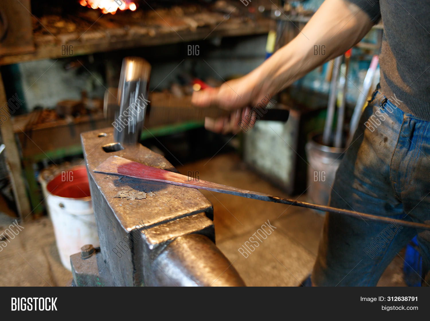 Unrecognizable Blacksmith Forging Red-hot Metal With Hammer. Blacksmithing Concept