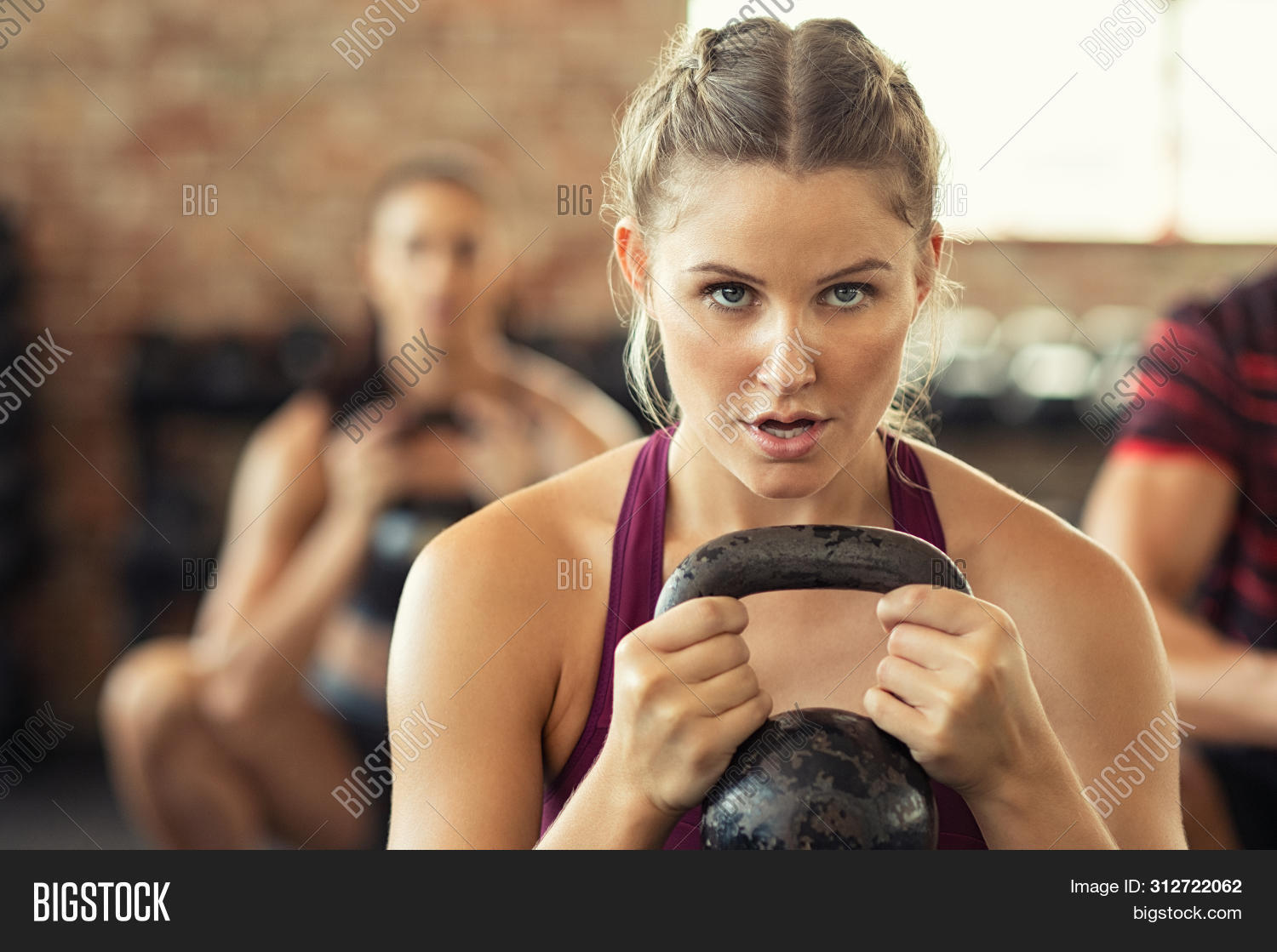 aerobic,attractive,challenge,class,closeup,dedication,determination,determination woman,determined woman,effort,endurance,exercise,face,fit,fitness,fitness girl,fitness training,focused athlete,girl,girl squat,girl squatting,group,gym,gym equipment,gym workout,healthy,heavy lifting,heavy weight,kettle,kettlebell,lifting,people,power,sport,sports,sports wear,squat,squat exercise,strength,strength training,strong,sweat,training,weight,well being,wellbeing,wellness,workout,young,young woman