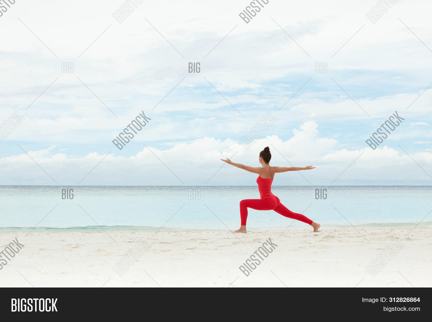 Yoga outdoor. Happy woman doing yoga exercises, meditate on the beach. Yoga meditation in nature. Co