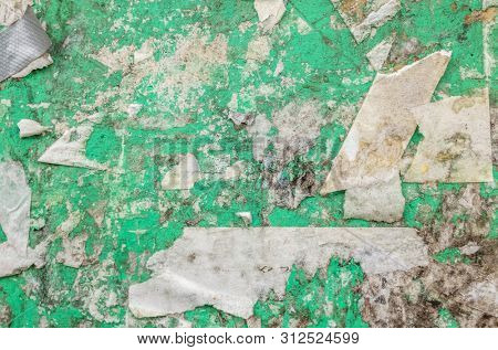 grungy green billboard wall with old tape residue stock photo