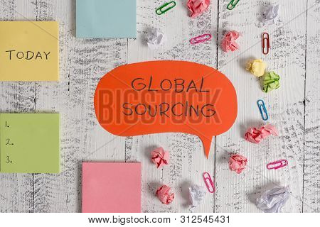 Word writing text Global Sourcing. Business concept for practice of sourcing from the global market for goods Blank speech bubble paper balls clips sticky notes old wooden background. stock photo