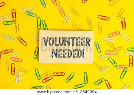 Text sign showing Volunteer Needed. Conceptual photo need work for organization without being paid. stock photo