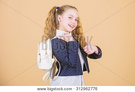 Stylish mini backpack. Girl little fashionable cutie carry backpack. Schoolgirl with small leather backpack. Carry bag comfortable. Popular useful fashion accessory. Learn how fit backpack correctly stock photo