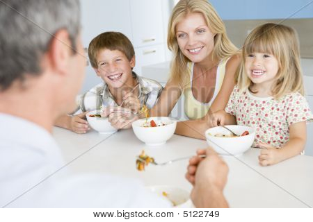Eating Family Happy Healthy Eating Smiling Togetherness 10 Year Old 30s 3 Year Old 40s Boys Brother Caucasian Child Color Colour Daughter Dining Room Enjoying Father Forties Girl Home Horizontal Image Indoors Man mealmealtime Mid Adult Middle Aged Mother  stock photo
