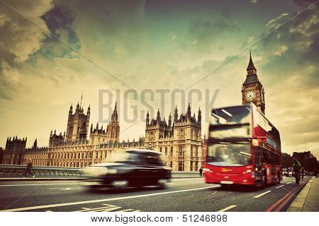 London, the uk. red bus, taxi cab in motion and big ben, the palace of westminster. the icons of eng