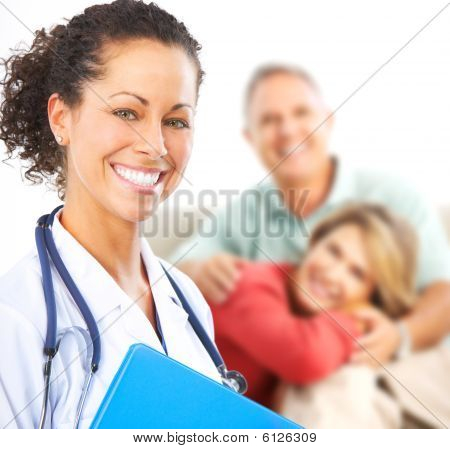 Smiling medical doctor with stethoscope and elderly couple stock photo