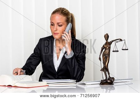 business woman sitting in an office. symbol photo for managers, independence or lawyer. stock photo
