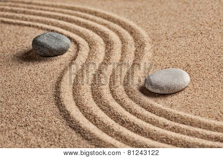 Japanese Zen stone garden - relaxation, meditation, simplicity and balance concept  - pebbles and ra