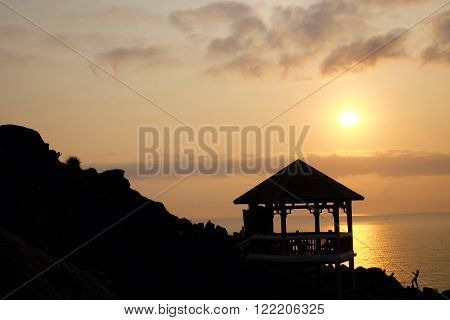 Silhouette of watch tower and people in morning at Dai Lanh cape Mui Dien Phu Yen Viet Nam yellow sun in sunrise make beautiful scene this place catch the first sunlight in Vietnam country stock photo