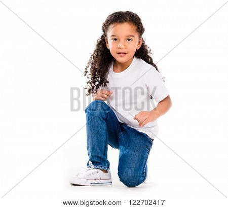 smiling little cute girl knelted on one knee stock photo