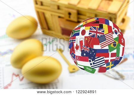 Flags globe over three golden eggs with a golden key and a wooden chest. Global long-term sustainable investment concept. stock photo