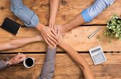 Closeup of business colleagues with their hands stacked. Business team showing unity with their hand