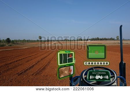 iot smart industry robot 4.0 agriculture concept,industrial agronomist,farmer using autonomous tractor with self driving technology , augmented mixed virtual reality to collect, access, analyze soil stock photo