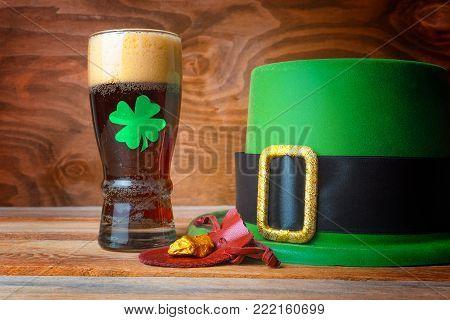 St. Patrick day symbols green alcohol drink shot, leprechaun hat and gold prills stock photo