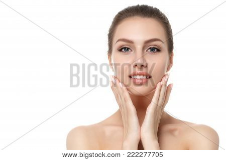 Portrait of young beautiful caucasian woman touching her face isolated over white background. Cleaning face, perfect skin. SPA therapy, skincare, cosmetology, hair removal or plastic surgery concept stock photo
