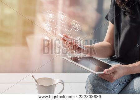 Internet of things - IOT via communication network service on mobile apps and smartphone and tablet technology for people in digital 4.0 lifestyle stock photo