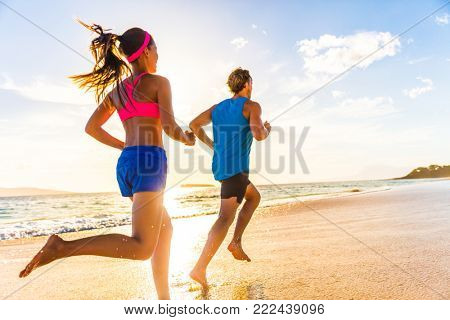 Runners fitness couple running training on beach. Morning cardio workout people doing exercise.Activ