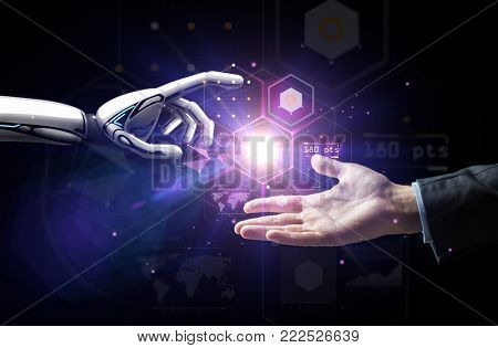 artificial intelligence, future technology and business concept - robot and human hand with flash li