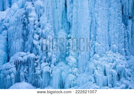 An extreme close up detail from a frozen waterfall in winter. stock photo