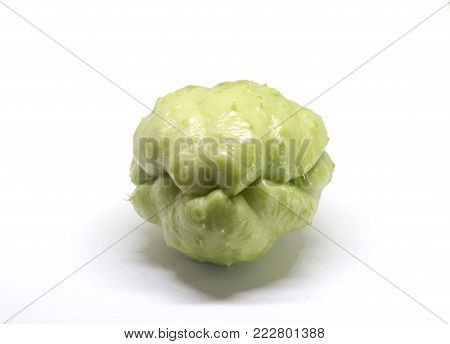 Chayote vegetable isolated on white. Exotic vegetable chayote studio photo. Green vegetable ingredient of mexican cuisine. Traditional Philippines food. Whole green chayote vegetable. Vegetarian food stock photo