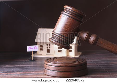 House for sale, auction hammer , symbol of authority and Miniature house . Courtroom concept stock photo