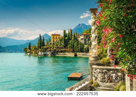 Famous luxury villa Monastero, stunning botanical garden decorated with mediterranean oleander flowers, lake Como, Varenna, Lombardy region, Italy, Europe