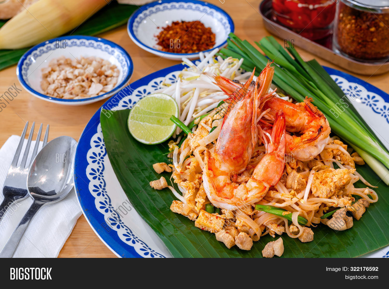 ancient,asia,asian,background,banana,blossom,cooking,cuisine,delicious,dinner,dish,drink,flat,food,fried,gourmet,homemade,ingredient,lay,leaf,lemon,local,lunch,meal,noodle,original,pad,pad-thai,peanuts,pepper,photography,plate,prawn,sauce,shrimp,spicy,stir,street,style,table,tasty,thai,top,traditional,vegetable,view,wooden