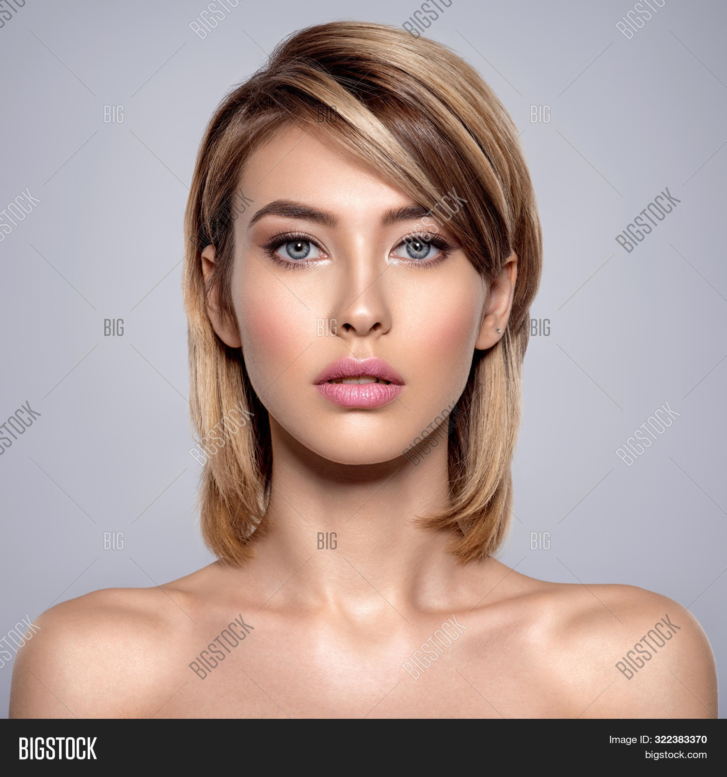 Front portrait of the woman with beauty face - isolated. Portrait of beautiful young blond woman wit