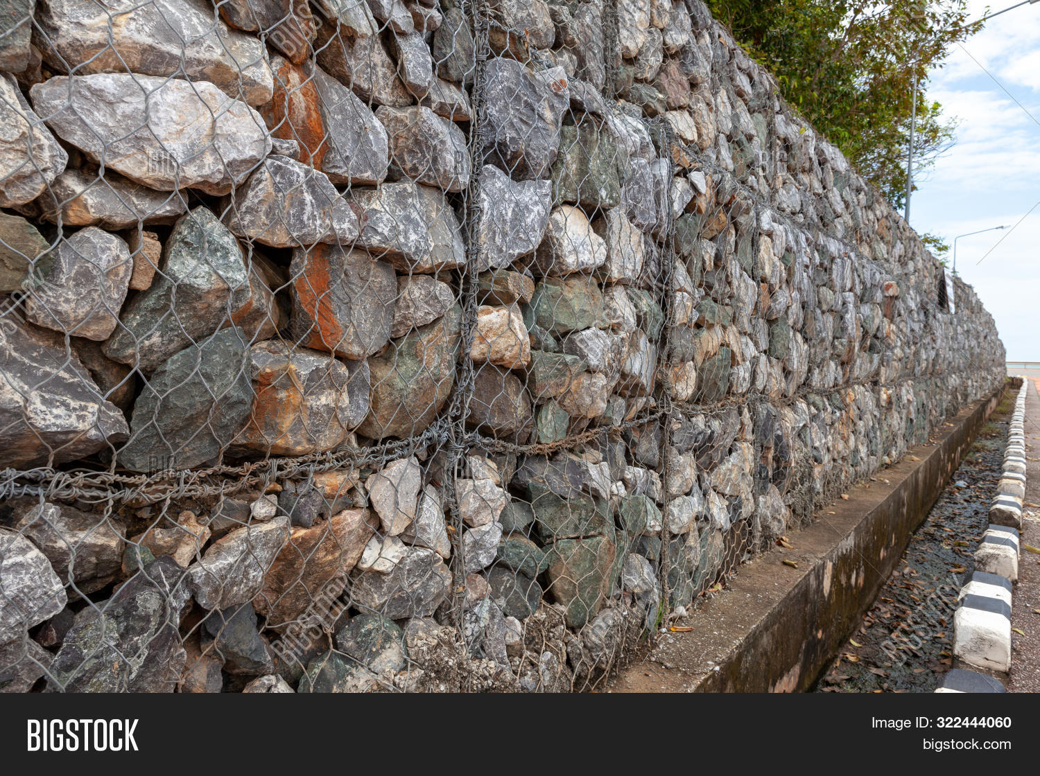 architecture,background,barrier,bars,basket,building,construction,contemporary,crushed,defend,design,erosion,exterior,fence,filled,gabion,galvanized,garden,gardening,granite,gravel,grid,horticulture,landscaping,landslide,material,mesh,metal,modern,natural,pattern,protection,protective,retaining,rock,stacked,steel,stone,stonewall,stonework,structure,surface,surroundings,texture,textured,wall,wire