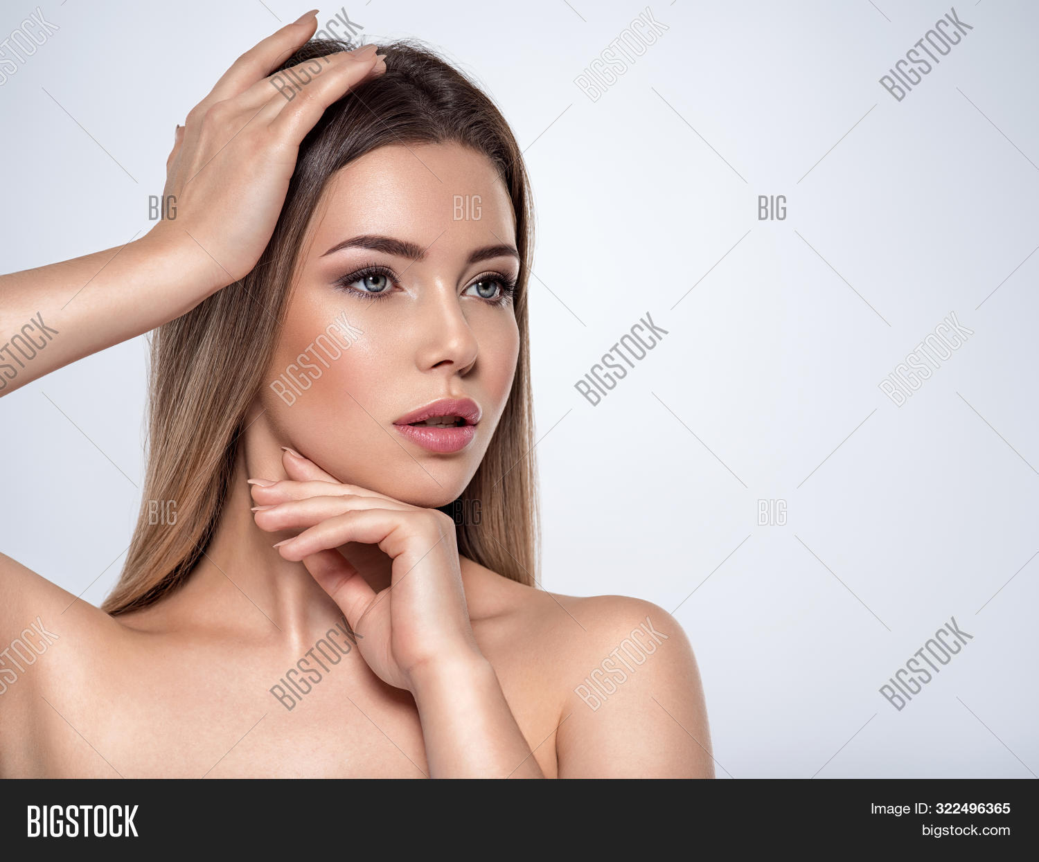 adult,attractive,beautiful,beauty,blue eyes,brunette,care,caucasian,clean,eyes,face,female,fresh,girl,hand,health,isolated,looking away,looking side,model,one,pamper,pampering,portrait,pose,posing,pretty,skin,skin care,smokey,smokey eyes,smokey makeup,studio,touch,white,white background,woman,young
