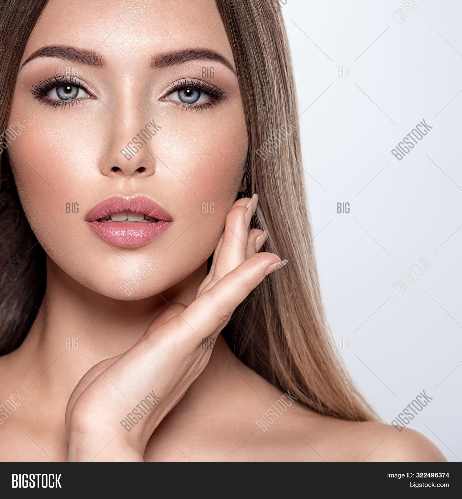 Beauty face of the young beautiful woman  with a fresh healthy skin. Closeup portrait of an attracti