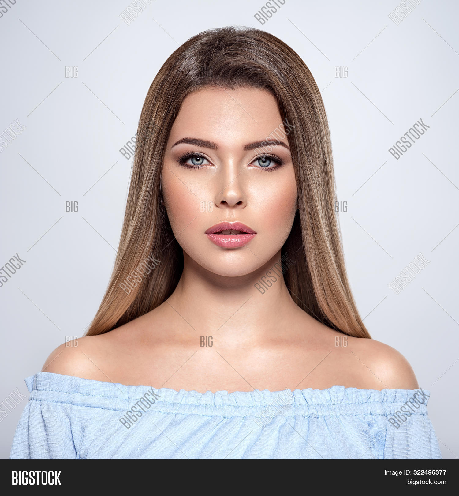 attractive,beautiful,beauty,blond,brown hair,caucasian,closeup,face,fashion,female,front,front portrait,girl,glamour,glossy,gray background,hair,hairstyle,long,long hair,make-up,makeup,model,one,portrait,posing,pretty,straight,straight hair,studio,style,vertical,white,woman,young