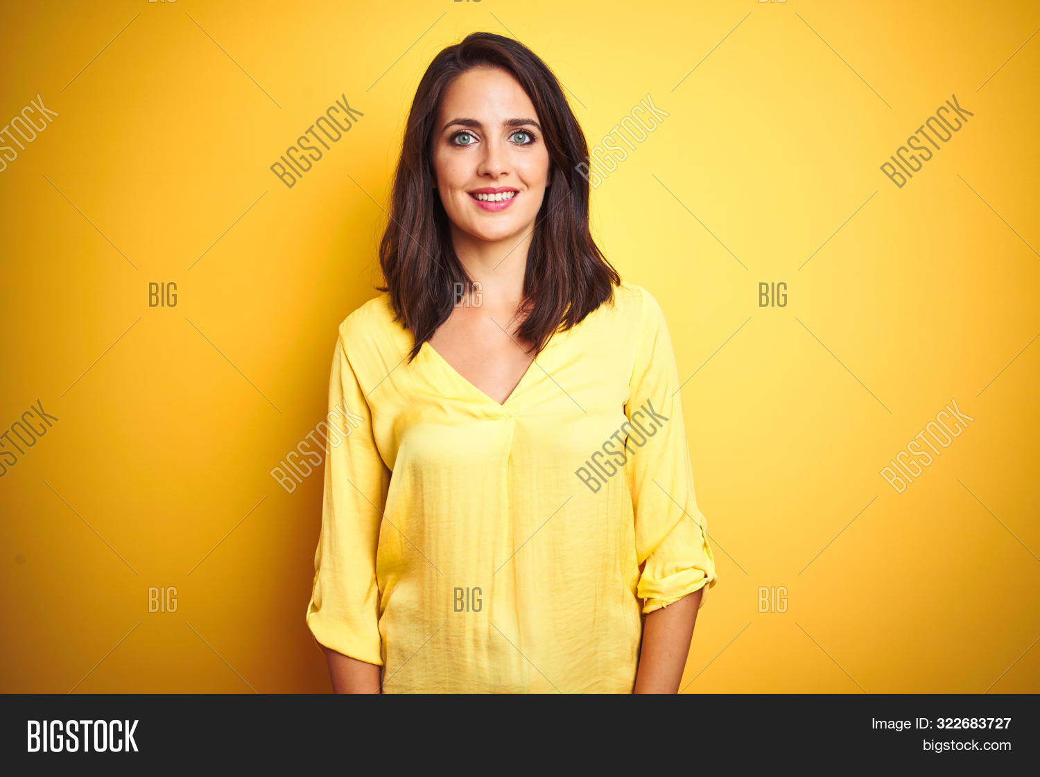 adult,attractive,background,beautiful,blue eyes,brunette,business,casual,caucasian,cheerful,confidence,confident,cool,elegant,excited,face,fashion,female,front,happiness,happy,isolated,joy,laugh,laughing,lifestyle,looking,lucky,mouth,natural,perfect,person,portrait,positive,proud,smile,smiling,standing,studio,style,success,teeth,trust,wall,watch,woman,yellow,young